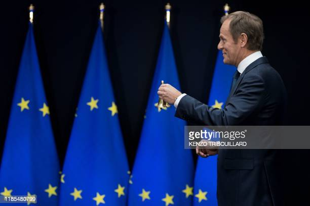 Outgoing European Council President Donald Tusk hands over the presidency ceremonial bell to newly appointed European Council President during the...