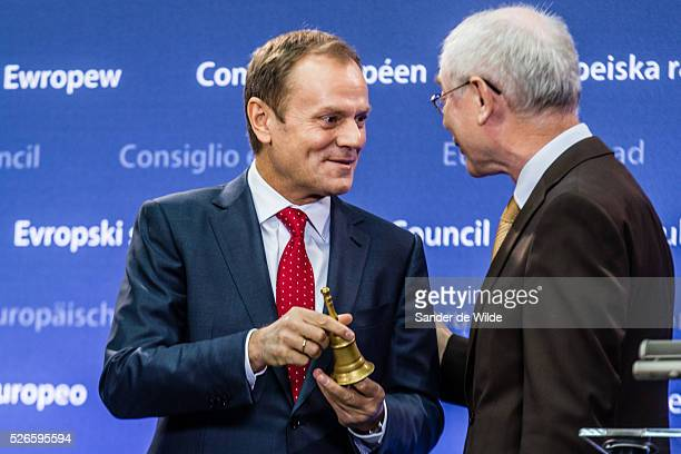 Outgoing European Council President Herman Van Rompuy right gave incoming European Council President Donald Tusk a bell during a handover ceremony...