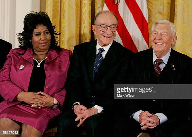 Outgoing Federal Reserve Board Chairman Alan Greenspan smiles during the reading of his bio while seated next to singer Aretha Franklin and actor...