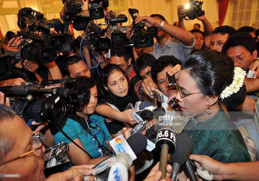 Outgoing Finance Minister Sri Mulyani Indrawati talks to journalists after the swearing in ceremony at the presidential palace in Jakarta on May 20, 2010. Indonesia's new finance minister faces an uphill struggle to restore investor's confidence after the shock resignation of his respected predecessor, analysts said. President Susilo Bambang Yudhoyono appointed PT Bank Mandiri chief Agus Martowardojo late on May 19, to replace independent economist Sri Mulyani Indrawati, who resigned on May 4 for a top job at the World Bank.