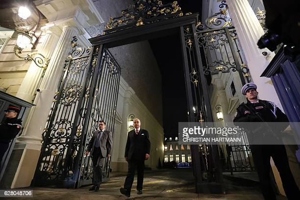 Outgoing French Interior Minister Bernard Cazeneuve leaves the Interior Ministry in Paris on December 6 2016 after a handover ceremony and following...