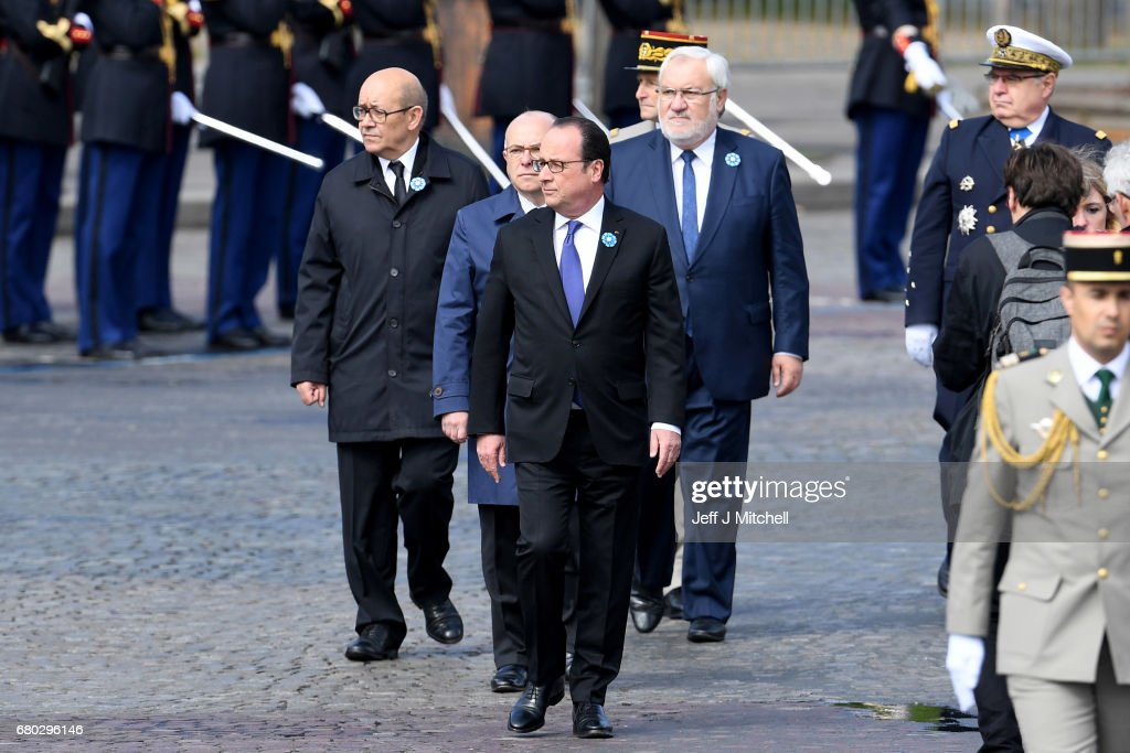 Outgoing French President Francois Hollande (front) attends a ceremony to mark the Western allies' World War Two victory in Europe at the Arc De Triumphe on May 8, 2017 in Paris, France. The ceremony marks the 72nd anniversary of the victory over Nazi Germany in 1945.