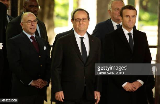 Outgoing French President François Hollande and newly elected French president Emmanuel Macron attend a ceremony at the Luxembourg Gardens to mark...