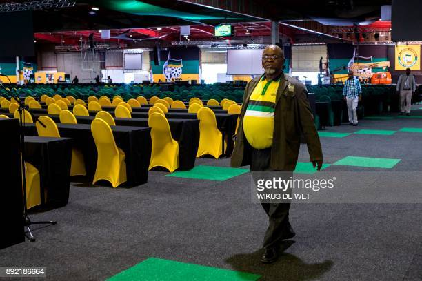 ANC outgoing General Secretary Gwede Mantashe walks in the main conference hall of the NASREC Expo Centre in Johannesburg on December 14 prior to the...