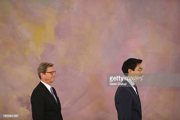 Outgoing German Foreign Minister Guido Westerwelle and outgoing Vice Chancellor and Economy Minister Philipp Roesler who are both members of the...