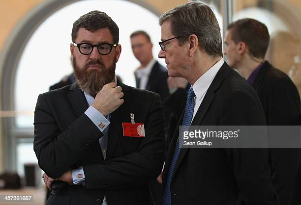 Outgoing German Foreign Minister Guido Westerwelle talks to Kai Diekmann Chief Editor at Bild tabloid at the Bundestag prior to ceremonies in which...