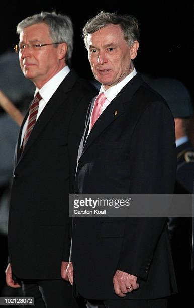 Outgoing German President Host Koehler and interim President Jens Boehrnsen attend the military tattoo at the Bellevue Palace on June 15, 2010 in...