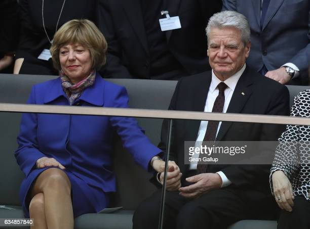 Outgoing German President Joachim Gauck holds the hand of First Lady Daniela Schadt during the election of the new president of Germany by the...