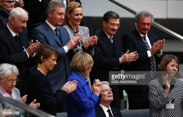 Outgoing German President Joachim Gauck is applauded by his Partner Daniela Schadt , German actor Armin Mueller-Stahl , former President Christian...