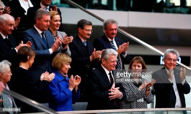 Outgoing German President Joachim Gauck is applauded by his Partner Daniela Schadt , German actor Armin Mueller-Stahl, former President Christian...