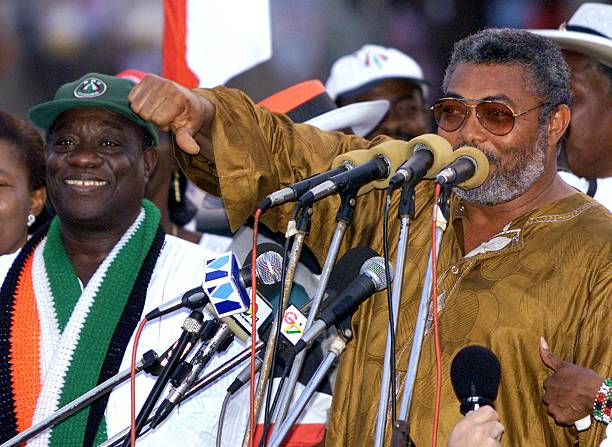 Outgoing Ghanean President Jerry Rawlings flanked by his chosen successor incumbent VicePresident John Mills addresses his supporters during an...