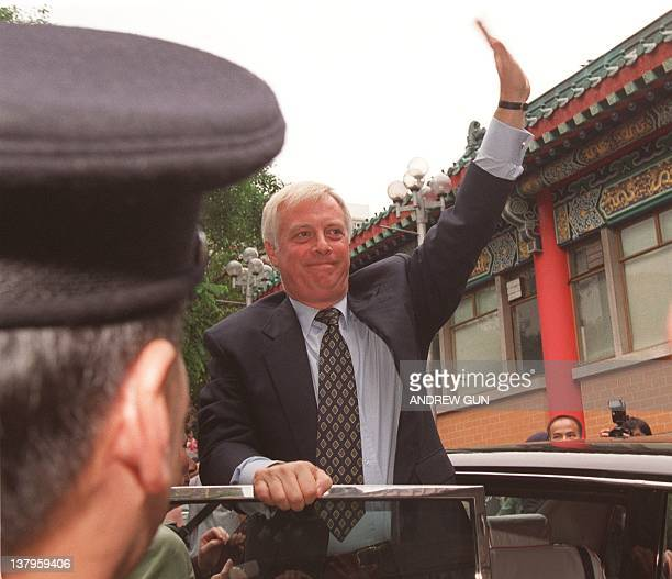 Outgoing Governor of Hong Kong Chris Patten waves to wellwishers after touring Wong Tai Sin temple one of the colony's favorite spots for worship 27...