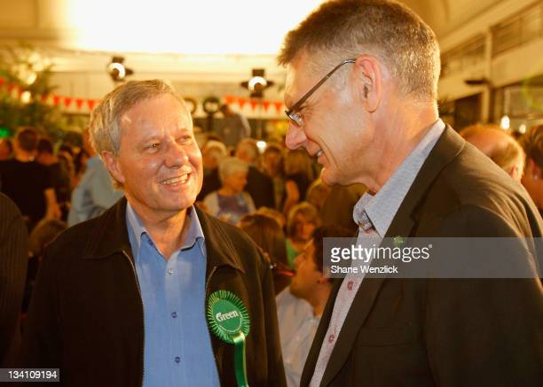 Outgoing Green MP Keith Locke chats with Green MP David Clendon as New Zealanders go to the polls during the 2011 General Election on November 26...