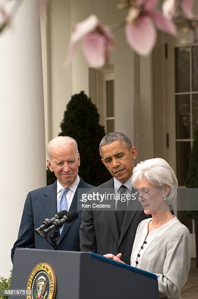 Outgoing Health and Human Services Secretary Kathleen Sebelius speaks as US President Barack Obama and Vice President Joe Biden look on in the Rose...