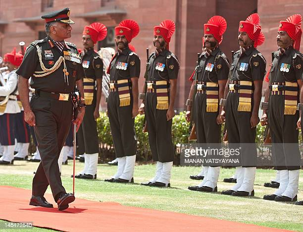 Outgoing Indian Army chief General VK Singh inspects a farewell guard of honour in New Delhi on May 31 2012 The head of the Indian army retired May...