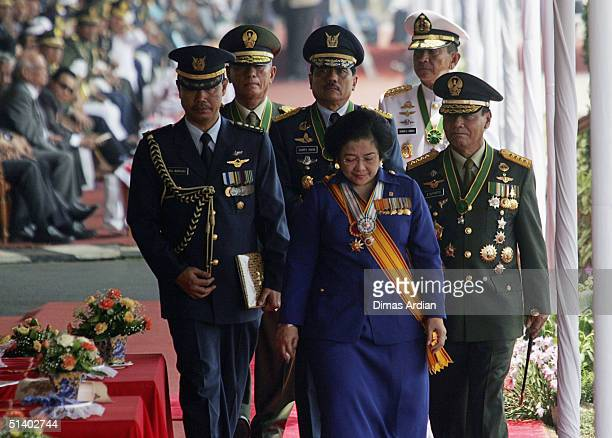 Outgoing Indonesian President Megawati Soekarnoputri strolls after giving speech at the celebrations for the 59th Anniversary of the Indonesian...