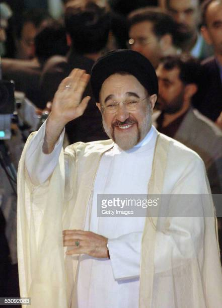 Outgoing Iranian reformist President, Mohammad Khatami, waves to the media as he arrives at the Interior Ministry to cast his ballot in the...