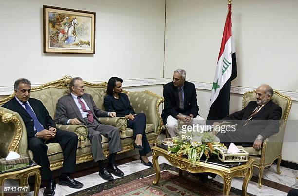 Outgoing Iraqi Prime Minister Ibrahim Jaafari meets with from left US Ambassador to Iraq Zalmay Khalilzad Defense Secretary Donald Rumsfeld and...