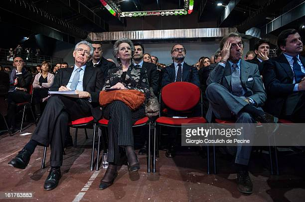 Outgoing Italian Prime Minister Mario Monti his wife Elsa Antonioli and President of Ferrari Luca Cordero di Montezemolo attend a campaign rally for...