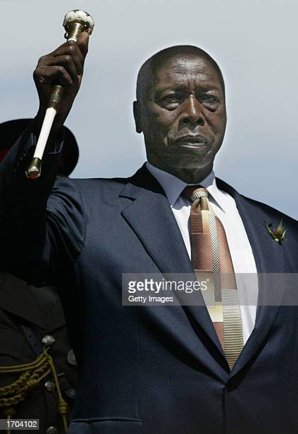 Outgoing Kenyan President Daniel arap Moi salutes during a swearingin ceremony for Presidentelect Mwai Kibaki December 30 2002 in Nairobi Kenya...
