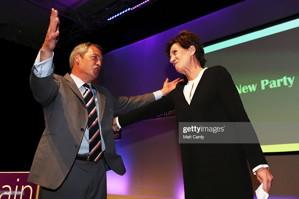 Outgoing leader Nigel Farage congratulates MEP Diane James as she is announced as the new leader of UKIP at the Bournemouth B.I.C where the United Kingdom Independent Party are holding their annual conference on September 16, 2016 in Bournemouth, England. UKIP are holding their first conference since the historic vote by the UK to leave the European Union. The conference is the last Nigel Farage will attend as leader after it was announced today that MEP Diane James will take up the position.