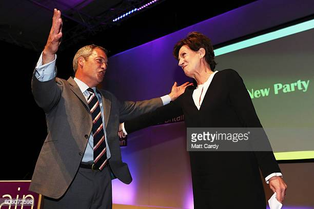 Outgoing leader Nigel Farage congratulates MEP Diane James as she is announced as the new leader of UKIP at the Bournemouth BIC where the United...