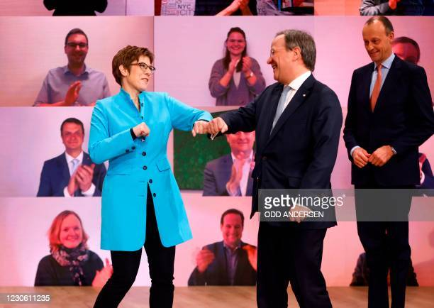 Outgoing leader of the Christian Democratic Union Annegret Kramp-Karrenbauer congratulates North Rhine-Westphalia's State Premier and candidate as...