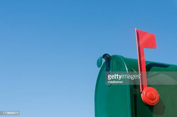 Outgoing mail in rural mailbox with flag in upright position