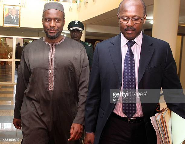 Outgoing Malian Prime Minister Oumar Tatam Ly and his successor Moussa Mara meet at the Prime Minister's office in Bamako on April 9 2014 Mali's new...