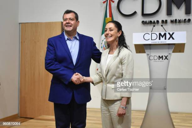Outgoing Mayor Jose Ramon Amieva and Newly elected Mayor of Mexico City Claudia Sheinbaum shake hands during a press conference at Antiguo Palacio...
