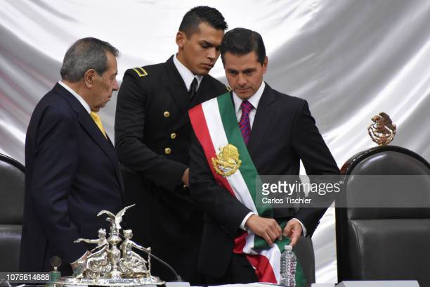 Outgoing Mexican President Enrique Peña Nieto takes off the presidential sash to Porfirio Munoz Ledo during the events of the Presidential...