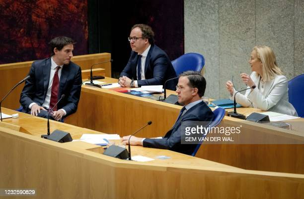 Outgoing Minister of Financial Affairs Wopke Hoekstra, outgoing Minister of Social Affairs Wouter Koolmees, outgoing Prime Minister Mark Rutte and...