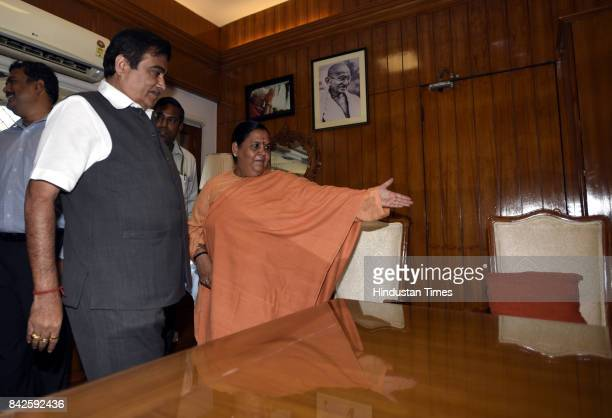 Outgoing Minister Uma Bharti welcomes the new Water Minister Nitin Gadkari to take over charge of his Ministry at Shramshakti Bhawan on September 4...