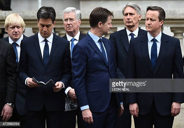 Outgoing opposition Labour Party leader Ed Miliband outgoing Liberal Democratic Party leader Nick Clegg and British Prime Minister David Cameron...