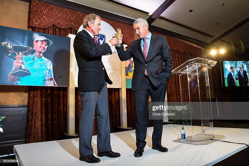 Outgoing PGA TOUR Commissioner Tim Finchem, left, is toasted by incoming Commissioner Jay Monahan during the PGA TOUR You Employee Meeting in the Ponte Vedra Room at TPC Sawgrass on November 7, 2016 in Ponte Vedra Beach, Florida.