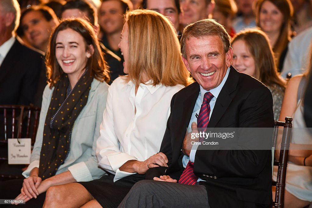 Outgoing PGA TOUR Commissioner Tim Finchem, right, smiles with his wife Holly and their daughter during the PGA TOUR You Employee Meeting in the Ponte Vedra Room at TPC Sawgrass on November 7, 2016 in Ponte Vedra Beach, Florida.