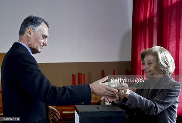 Outgoing Portuguese president and candidate Anibal Cavaco Silva votes at a polling station in the Bartolomeu de Gusmao School in Lisbon on January...