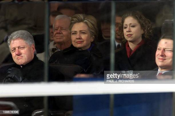 Outgoing President Bill Clinton former First Lady and now US Senator Hillary Clinton daughter Chelsea and outgoing Vice President Al Gore watch the...
