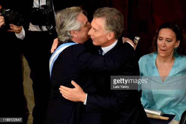 Outgoing President of Argentina Mauricio Macri greets Argentina Presidentelect Alberto Fernandez during the Presidential Inauguration Ceremony at...