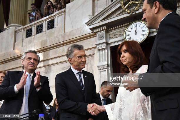 Outgoing President of Argentina Mauricio Macri greets Argentina Vice President-elect Cristina Fernández de Kirchner during the Presidential...