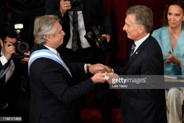 Outgoing President of Argentina Mauricio Macri passes the presidential cane to Argentina Presidentelect Alberto Fernandez during the Presidential...