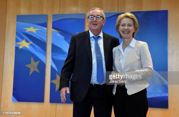Outgoing president of the European Commission JeanClaude Juncker welcomes German Defence Minister and newlyappointed EU Commission Chief Ursula von...