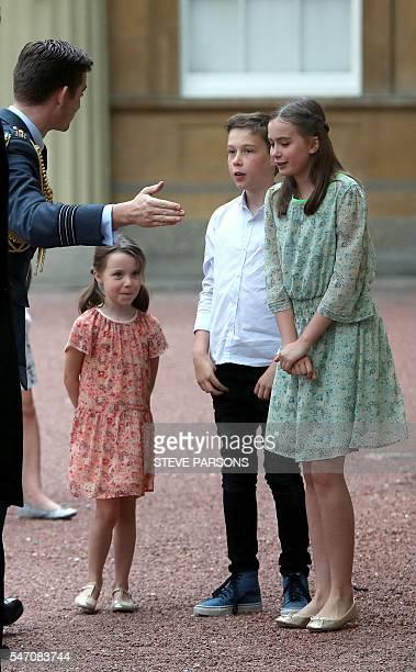 Outgoing prime minister David Cameron's children daughter Florence Rose Endellion son Arthur Elwen and daughter Nancy Gwen arrive at Buckingham...