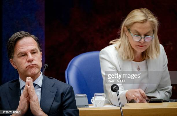 Outgoing Prime Minister Mark Rutte and outgoing Minister of Foreign Trade Sigrid Kaag listen on during a new debate on the benefits affair in the...