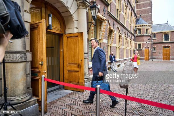 Outgoing Prime Minister Mark Rutte arrives for a briefing on the situation amid the Covid-19 pandemic at the Binnenhof in the Hague, on July 26,...
