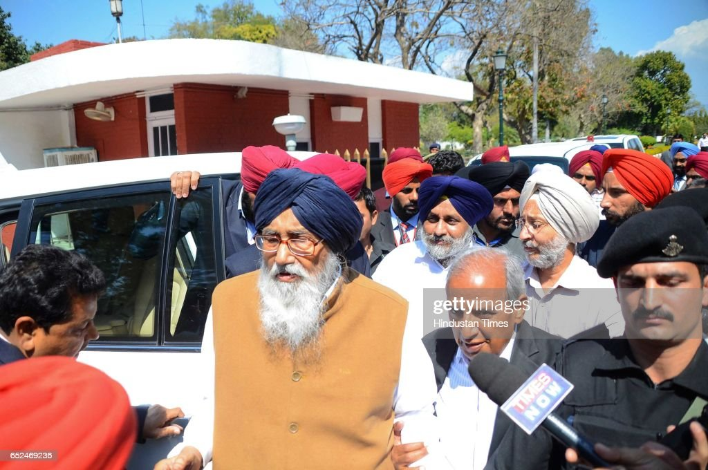 Outgoing Punjab Chief Minister Parkash Singh Badal with Sukhbir Singh Badal ExDeputy Chief Minister coming out from Punjab Governor house after...