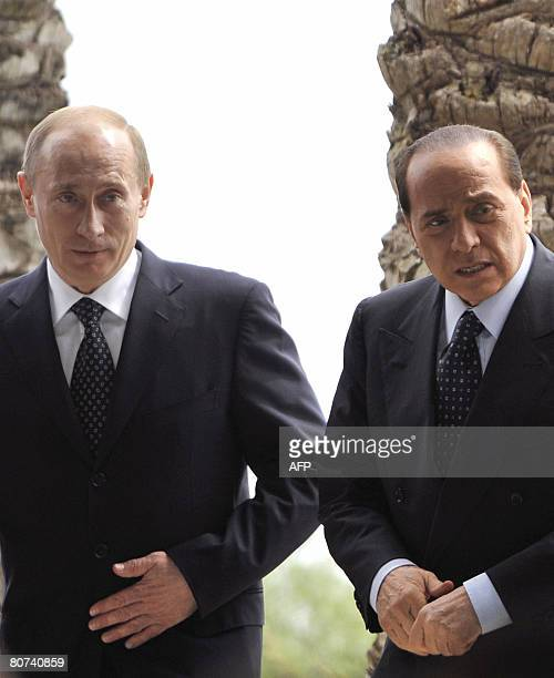 Outgoing Russian President Vladimir Putin and Italian Prime Ministerelect Silvio Berlusconi arrive to attend a joint press conference at Berlusconi's...