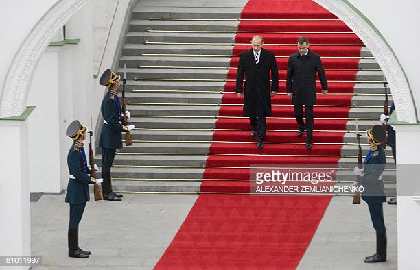 Outgoing Russian President Vladimir Putin and new Russian President Dmitry Medvedev walk down steps during an inauguration ceremony for Medvedev in...