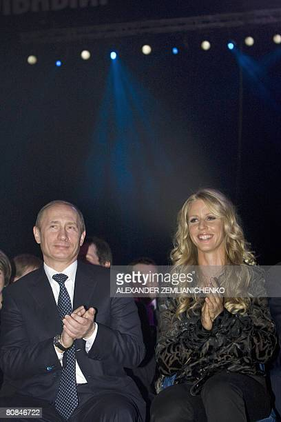 Outgoing Russian President Vladimir Putin and tennis player Yelena Dementyeva attend a ceremony marking the 85th anniversary of the Russian sports...