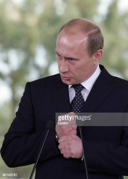Outgoing Russian President Vladimir Putin attends a joint press conference with Italian Prime Ministerelect Silvio Berlusconi at Berlusconi's private...